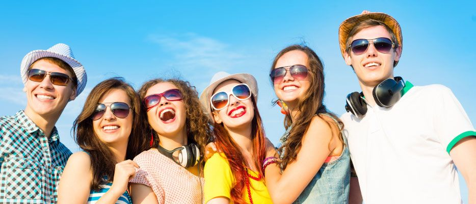 young people smiling with sunglasses on